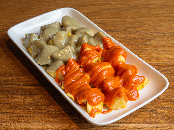Potatoes with spicy sauce bravocabrales in Madrid
